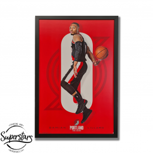 A poster of Damian Lillard holding a basketball. There is alot of red in the background, it has been framed